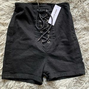 urban outfitters black lace up high waisted shorts